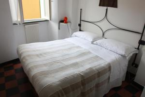 A bed or beds in a room at Hotel Gianni Franzi