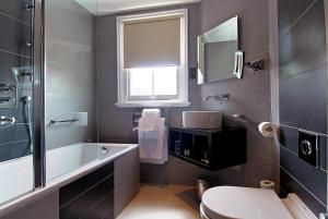 A bathroom at The Marble Arch Suites