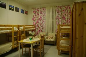 A bunk bed or bunk beds in a room at Aneen Loma Vacation and Cottages