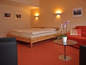 Ein Bett oder Betten in einem Zimmer der Unterkunft Hotel Steinbock