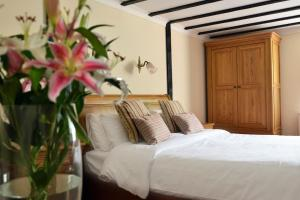 A bed or beds in a room at The Brickwall Hotel