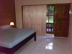 A bed or beds in a room at Bayu Mantra Bungalows