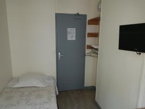 Un ou plusieurs lits dans un hébergement de l'établissement Au Royal Mad