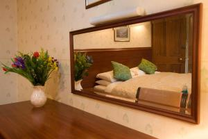 A bed or beds in a room at Coila Guest House