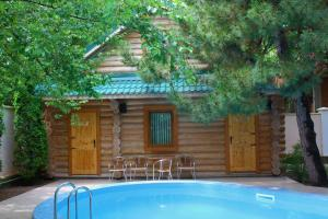 The swimming pool at or close to Guest House Sosnovaya Dacha