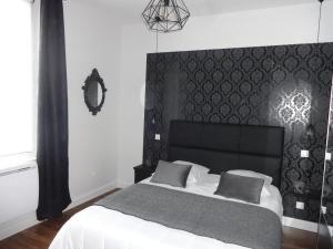 Un ou plusieurs lits dans un hébergement de l'établissement Le Cocon d'Aurore