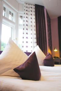 Ein Bett oder Betten in einem Zimmer der Unterkunft Kleine Villa Frankfurt