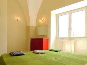 Letto o letti in una camera di Oikia Vacanze Diso Giulia