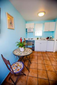 A kitchen or kitchenette at Leucadia Beach Inn