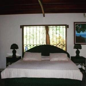 A bed or beds in a room at Casa Paraíso
