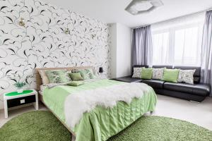 A bed or beds in a room at Spacious Luxury Apartments