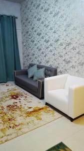 Ruang duduk di Aliya Muslims Homestay CH