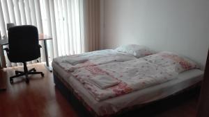 Кровать или кровати в номере Apartman Mickiewiczova 14