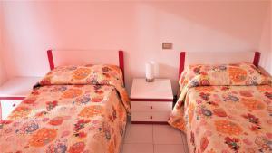 Кровать или кровати в номере Residenza Alberghiera Italia