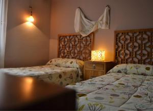 Ein Bett oder Betten in einem Zimmer der Unterkunft La Aldea Encantada