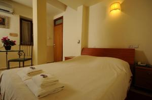 A bed or beds in a room at Hapina-Shel-Michal Hotel