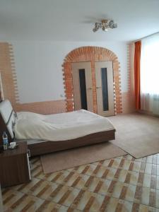 Кровать или кровати в номере Mini-Hotel Astoria