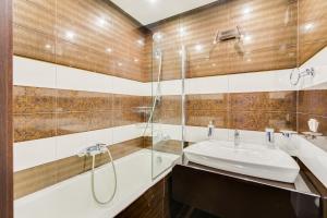 A bathroom at Paradise Apartment