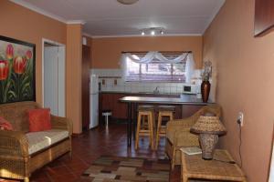 A kitchen or kitchenette at Anja Gastehuis
