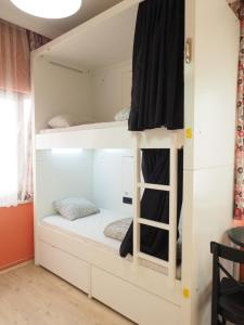 A bunk bed or bunk beds in a room at Deeps Hostel