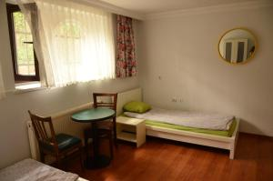 A bed or beds in a room at Deeps Hostel
