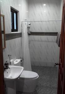 A bathroom at Alona Pawikan Resort