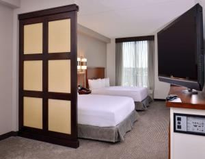 A bed or beds in a room at Hyatt Place Garden City