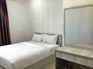 Кровать или кровати в номере Vouk Suites At Mansion One