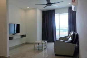 Телевизор и/или развлекательный центр в Vouk Suites At Mansion One