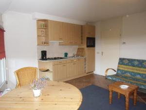 Een keuken of kitchenette bij Scheibershof appartementenverhuur