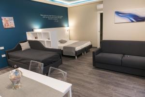 Letto o letti in una camera di Residence del sole Manfredonia