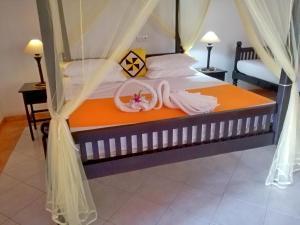 Кровать или кровати в номере Haus Berlin