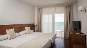 Cama o camas de una habitación en Carlos III
