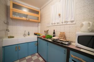 A kitchen or kitchenette at Le Val Duchesse Hotel & Appartements