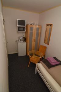 Ein Sitzbereich in der Unterkunft Hotel Pension Südring