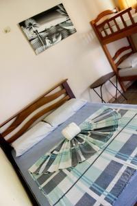 A bed or beds in a room at Pousada Novo Airão