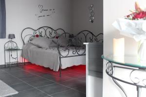 Un ou plusieurs lits dans un hébergement de l'établissement Au plaisir des sens