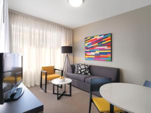 A seating area at Adina Apartment Hotel Norwest Sydney