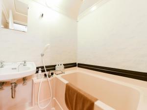 Ванная комната в Tanegashima Araki Hotel