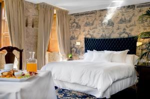Un ou plusieurs lits dans un hébergement de l'établissement A Quinta Da Auga Hotel Spa Relais & Chateaux