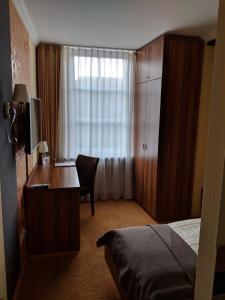 Ein Bett oder Betten in einem Zimmer der Unterkunft Dagstuhler Hof
