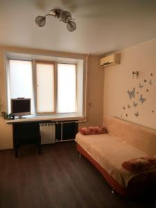 Кровать или кровати в номере Апартаменты у метро