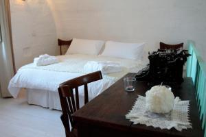 Letto o letti in una camera di Albergo Diffuso Il Casale