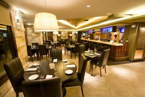 A restaurant or other place to eat at Imago Hotel & Spa