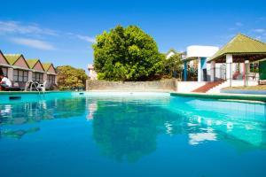 The swimming pool at or near Hotel Faranda Guayacanes