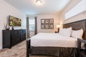 A bed or beds in a room at Outstanding Home with Water Park Access near Disney - 7731F