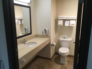 A bathroom at Days Inn by Wyndham West Yellowstone