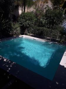 The swimming pool at or near Le Jardin Des Biehn