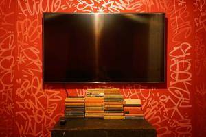 A television and/or entertainment center at The Walled Off Hotel