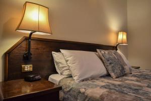 A bed or beds in a room at The Crossing Motel